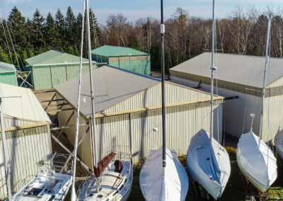 mast up sailboats and storage buildings